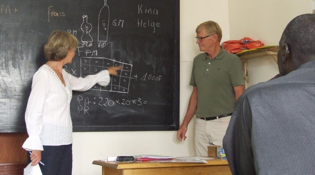 Students in Africa attend a maths class taught by older adults volunteering abroad on a Projects Abroad Micro-finance Project.